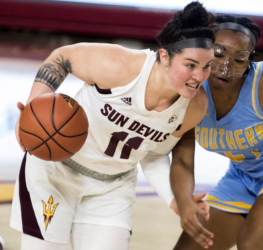 Arizona State University's Robbi Ryan (11) drives against against Southern's Jaden Towner (24) during the first half of their game in Tempe, Friday, Dec. 7, 2018. Darryl Webb/Special for the Republic