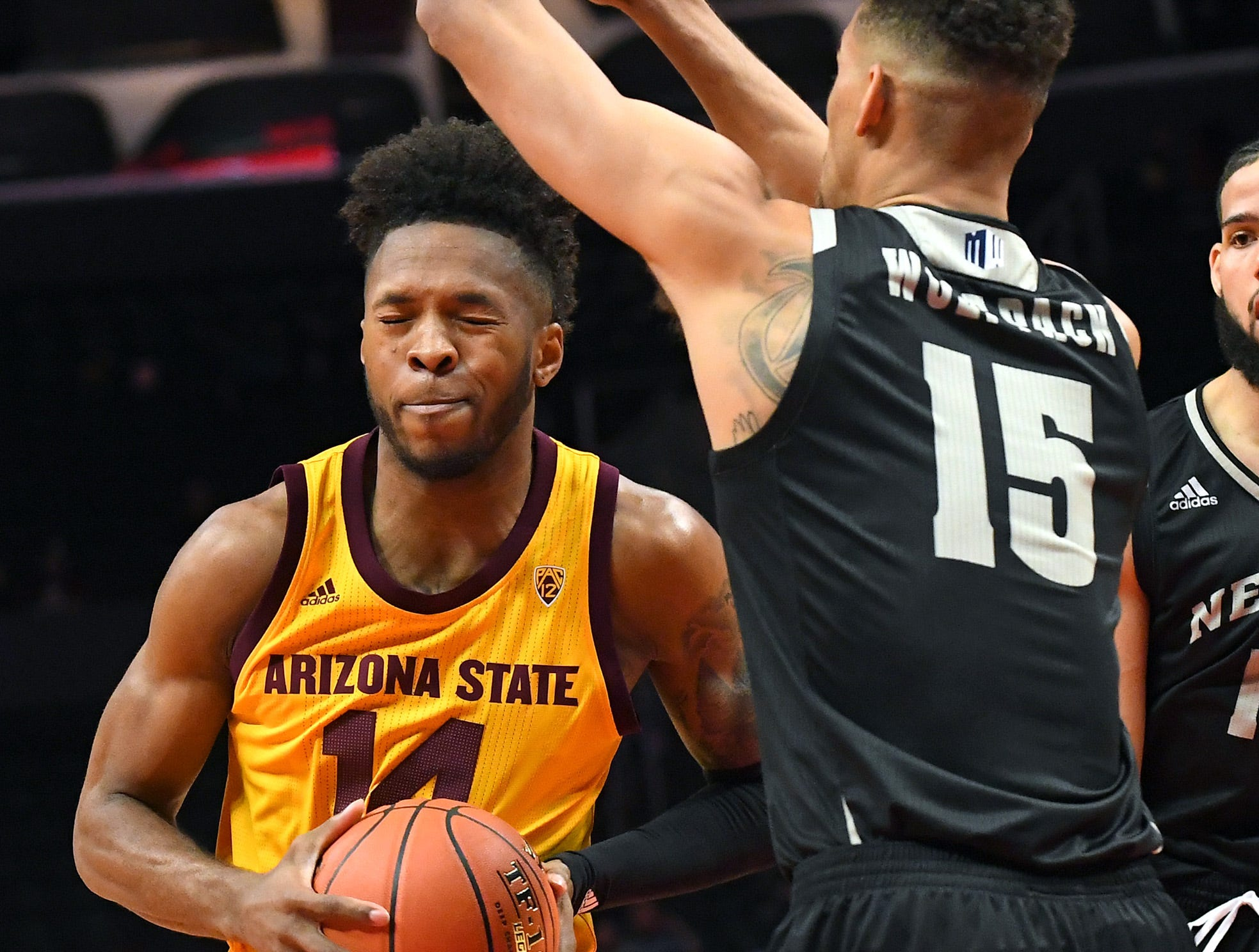 Dec 7, 2018; Los Angeles, CA, USA;  Arizona State Sun Devils forward Kimani Lawrence (14) is fouled by Nevada Wolf Pack forward Trey Porter (15) as he goes for a basket in the first half of the game at Staples Center. Mandatory Credit: Jayne Kamin-Oncea-USA TODAY Sports
