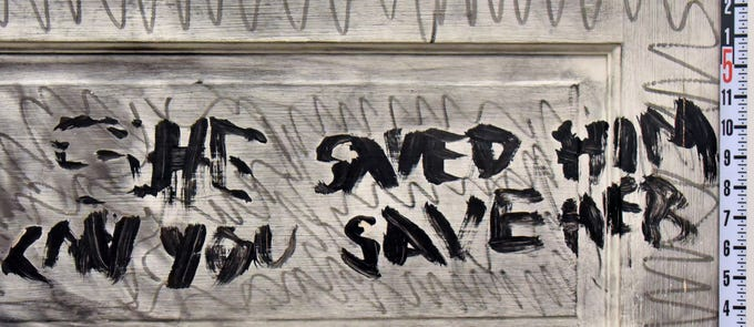"A close-up image of the door with the words:  ""She saved him. Can you save her."" Investigators said Rebecca Zahau wrote this before killing herself."