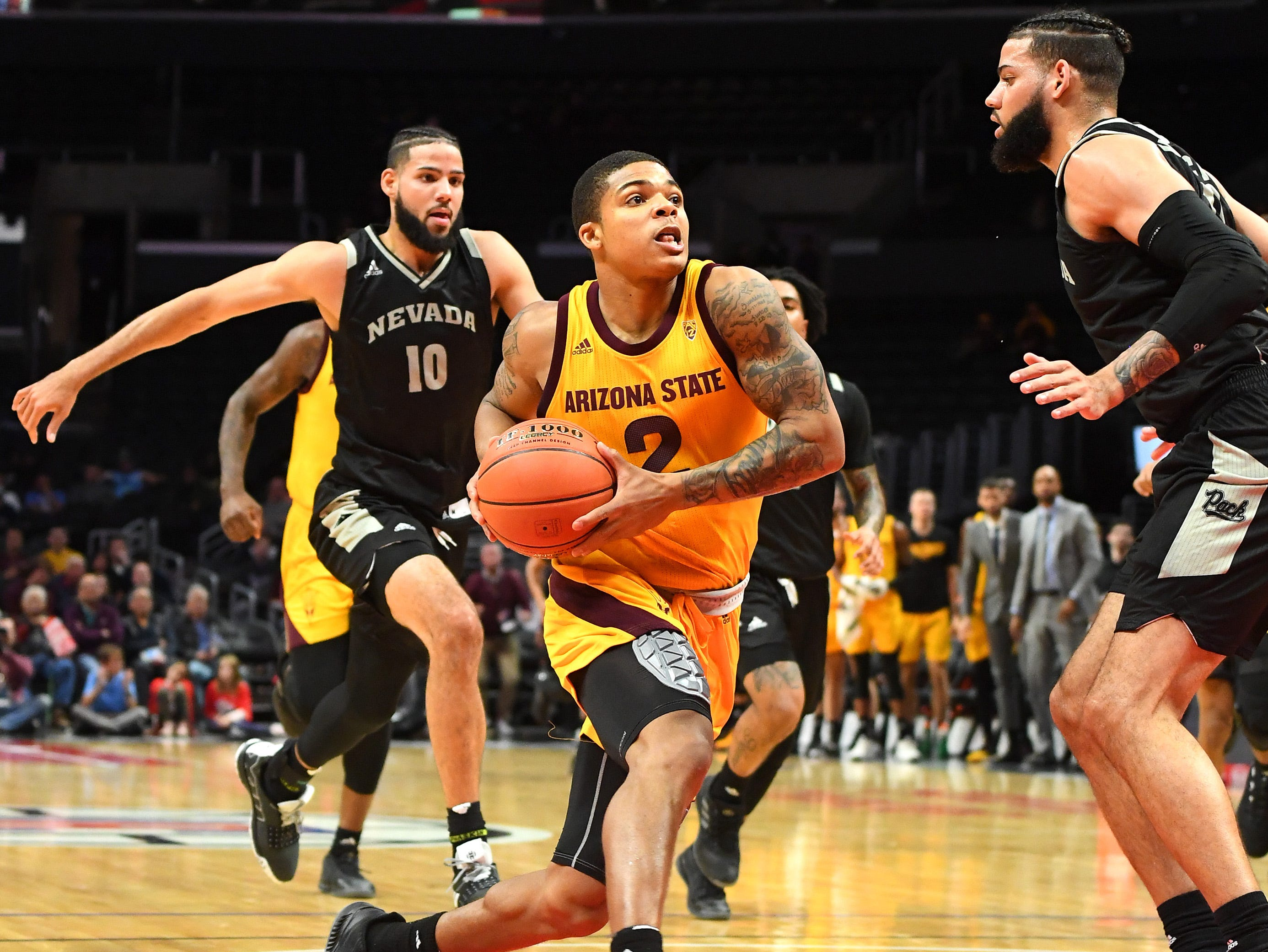 Dec 7, 2018; Los Angeles, CA, USA; Arizona State Sun Devils guard Rob Edwards (2) gets past Nevada Wolf Pack forward Cody Martin (11) and forward Caleb Martin (10) for a basket in the first half of the game at Staples Center. Mandatory Credit: Jayne Kamin-Oncea-USA TODAY Sports