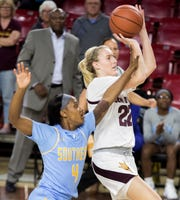 Arizona State University's Courtney Ekmark (22) puts up a shot against Southern's Skylar O'Bear during the first half of their game in Tempe, Friday, Dec. 7, 2018. Darryl Webb/Special for the Republic