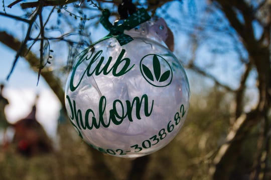Ornaments hang from a tree at the top of Camelback Mountain in Phoenix, Arizona on Dec. 8, 2018.