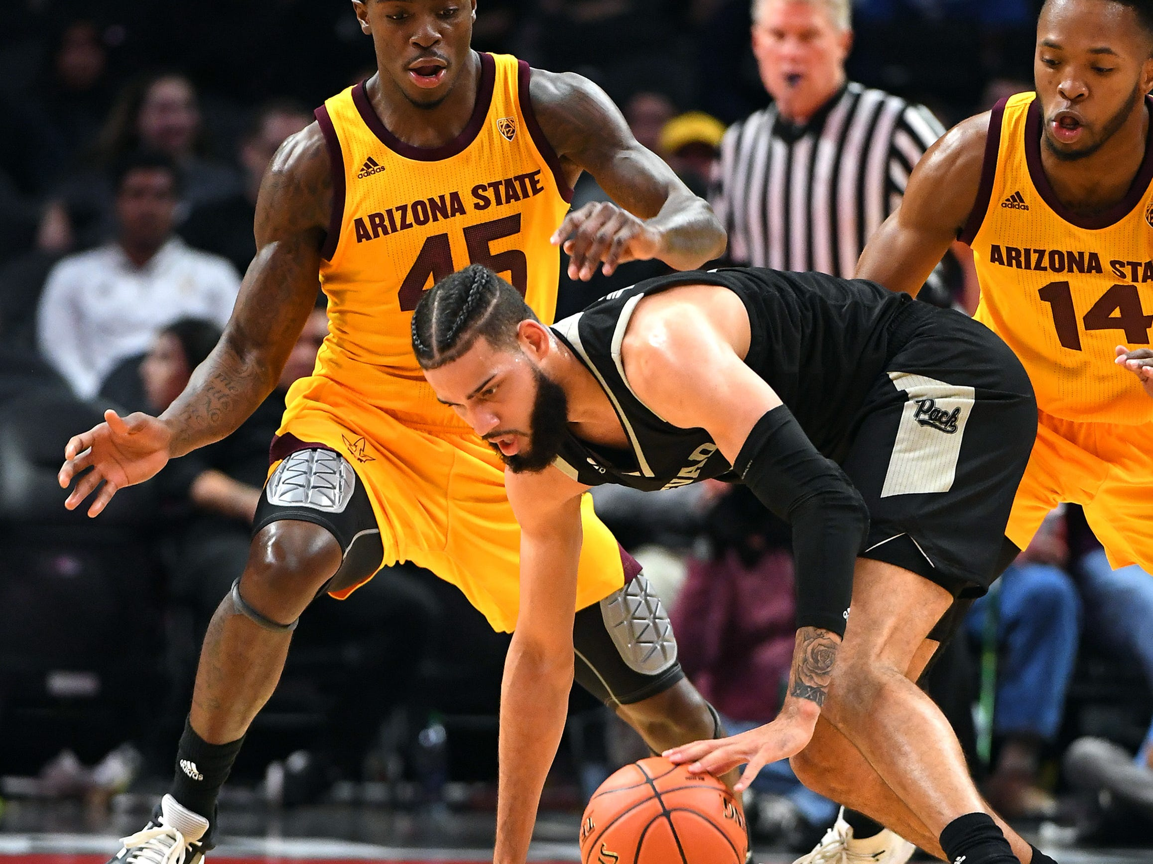 Dec 7, 2018; Los Angeles, CA, USA;  Arizona State Sun Devils forward Zylan Cheatham (45) and forward Kimani Lawrence (14) pressure Nevada Wolf Pack forward Cody Martin (11) as he takes it down court in the first half of the game at Staples Center. Mandatory Credit: Jayne Kamin-Oncea-USA TODAY Sports