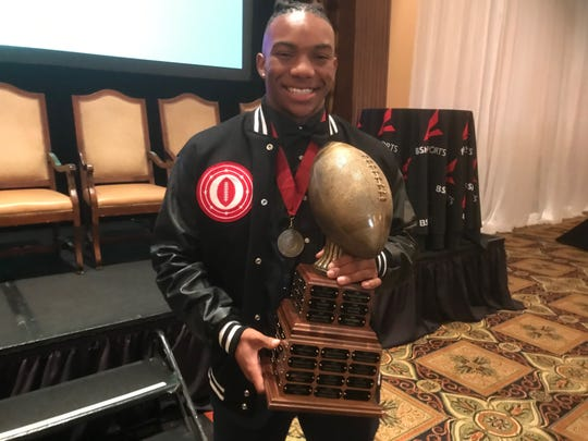 Bijan Robinson poses with the Ed Doherty Award on Saturday.