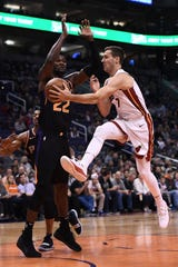Dec 7, 2018; Phoenix, AZ, USA; Miami Heat guard Goran Dragic (7) makes a pass in front of Phoenix Suns center Deandre Ayton (22) in the first half at Talking Stick Resort Arena. Mandatory Credit: Jennifer Stewart-USA TODAY Sports