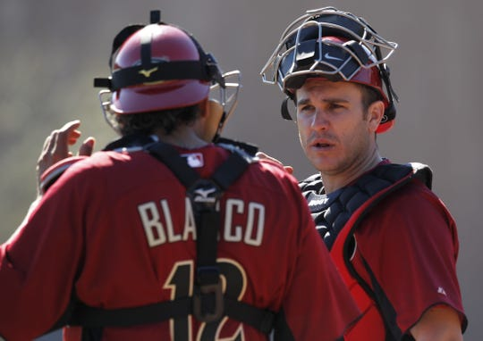 Diamondbacks catcher Miguel Montero talks to Henry Blanco during a spring training workouts at Salt River Fields in 2011.
