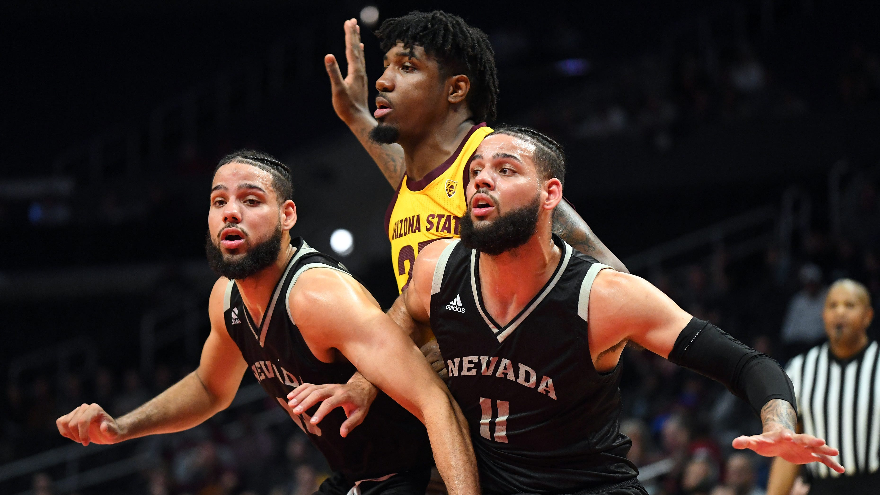 Dec 7, 2018; Los Angeles, CA, USA;Nevada Wolf Pack forward Cody Martin (11) and forward Caleb Martin (10) box out Arizona State Sun Devils forward Romello White (23) under the basket in the first half of the game at Staples Center. Mandatory Credit: Jayne Kamin-Oncea-USA TODAY Sports