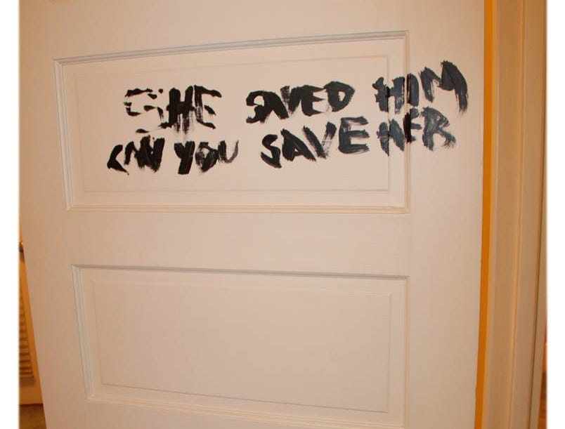 "Police say this is the message Rebecca Zahau painted on a bedroom door before hanging herself. It says:  ""She saved him. Can you save her."""