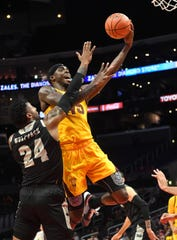 Dec 7, 2018; Los Angeles, CA, USA;  Nevada Wolf Pack forward Jordan Caroline (24) defends Arizona State Sun Devils forward Zylan Cheatham (45) in the first half of the game at Staples Center. Mandatory Credit: Jayne Kamin-Oncea-USA TODAY Sports