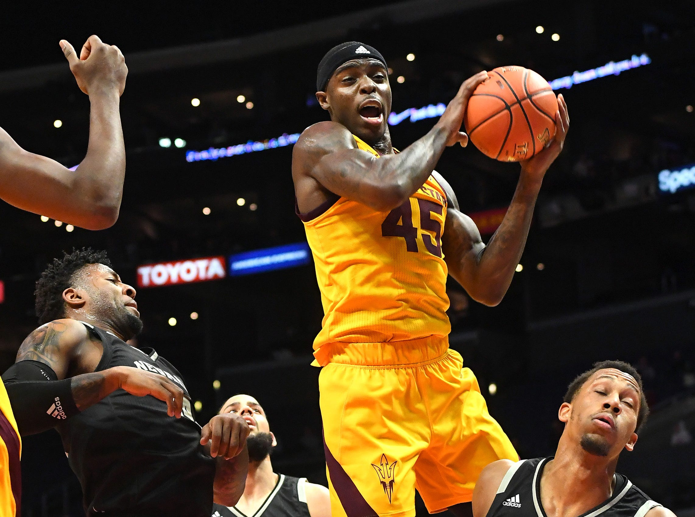 Dec 7, 2018; Los Angeles, CA, USA;  Arizona State Sun Devils forward Zylan Cheatham (45) grabs a rebound in the first half of the game against the Nevada Wolf Pack at Staples Center. Mandatory Credit: Jayne Kamin-Oncea-USA TODAY Sports