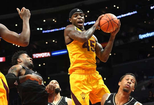 ASU forward Zylan Cheatham grabs a rebound  during the first half of a game against Nevada on Dec. 7 at Staples Center.