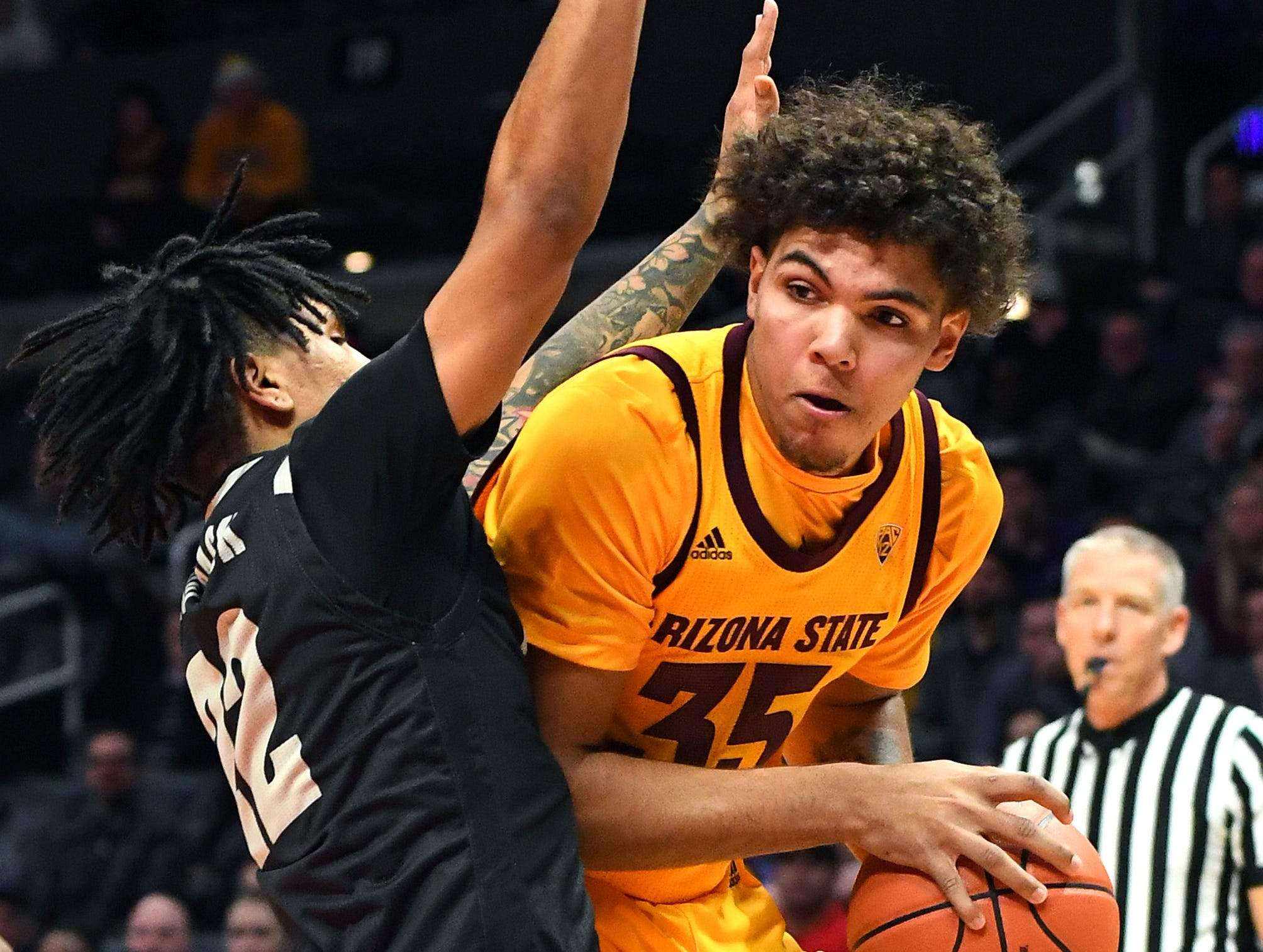 Dec 7, 2018; Los Angeles, CA, USA;  Nevada Wolf Pack guard Jazz Johnson (22) defends Arizona State Sun Devils forward Taeshon Cherry (35) under the basket in the first half of the game at Staples Center. Mandatory Credit: Jayne Kamin-Oncea-USA TODAY Sports