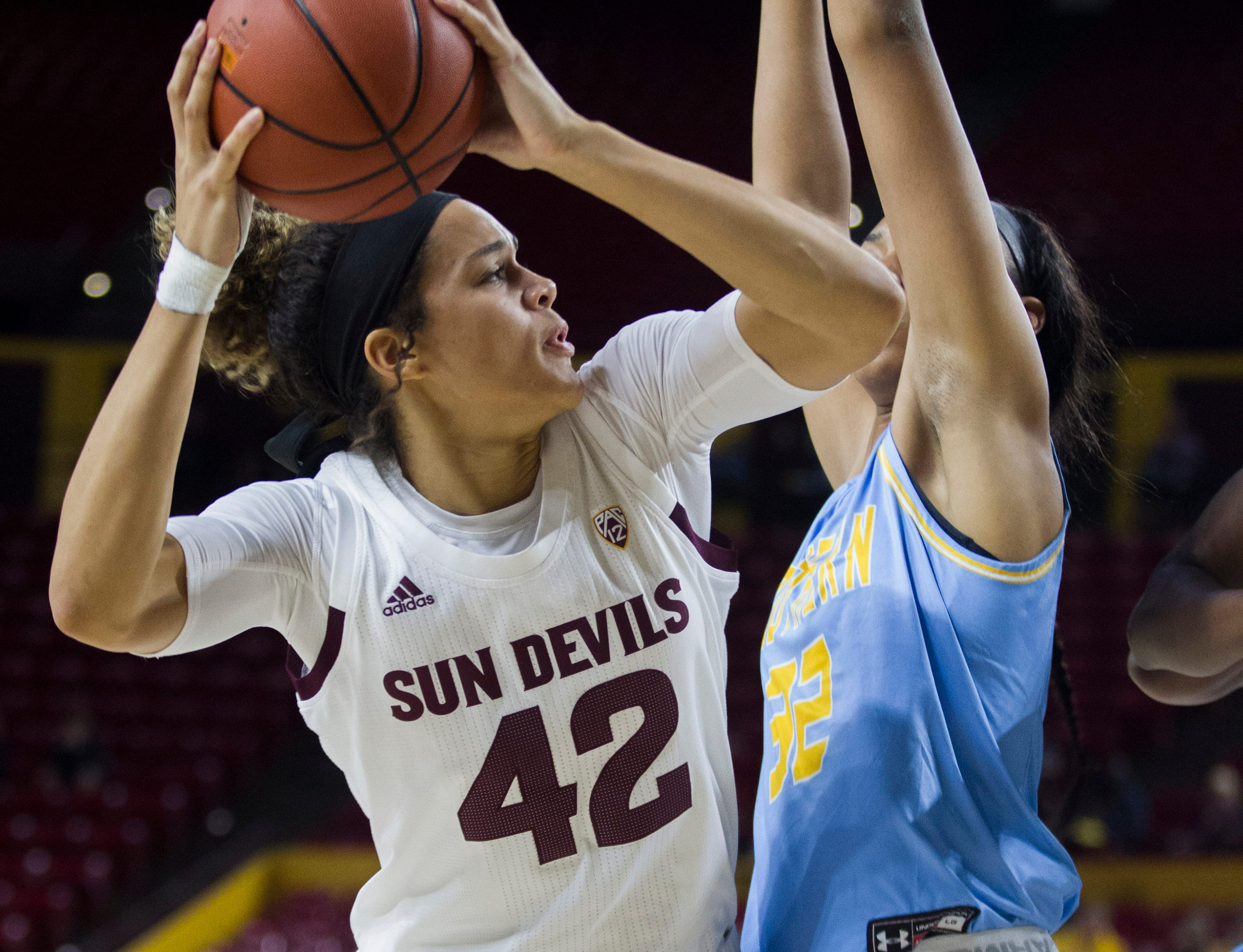 Arizona State University's Kianna Ibis looks to the basket against Southern's Ceundra McGhee during the first half of their game in Tempe, Friday, Dec. 7, 2018. Darryl Webb/Special for the Republic