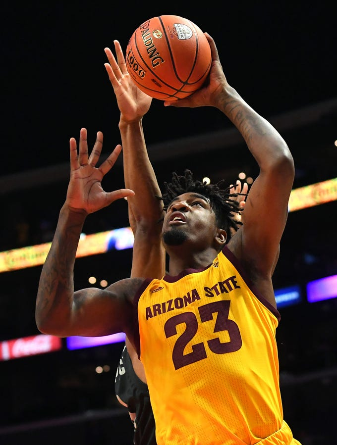 Dec 7, 2018; Los Angeles, CA, USA; Arizona State Sun Devils forward Romello White (23) gets past Nevada Wolf Pack forward Tre'Shawn Thurman (0) for a basket in the first half of the game at Staples Center. Mandatory Credit: Jayne Kamin-Oncea-USA TODAY Sports