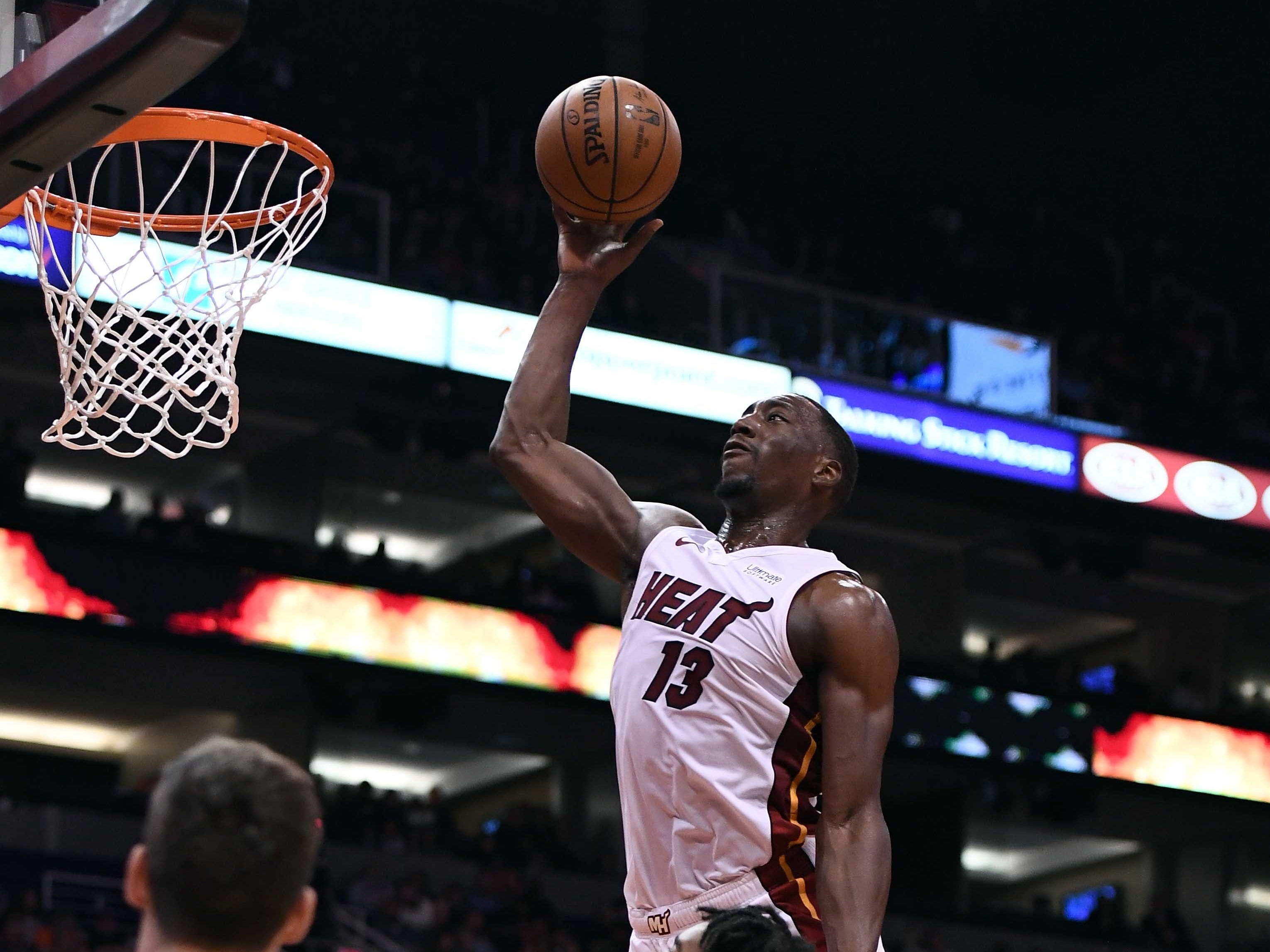 Dec 7, 2018; Phoenix, AZ, USA; Miami Heat center Bam Adebayo (13) dunks the ball against the Phoenix Suns in the first half at Talking Stick Resort Arena. Mandatory Credit: Jennifer Stewart-USA TODAY Sports