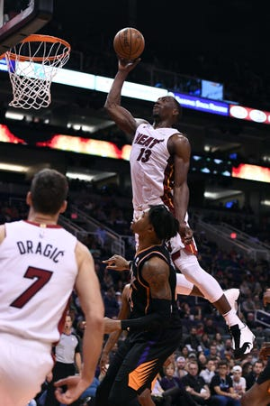 Heat center Bam Adebayo goes up for a dunk against the Suns during the first half of a game Friday at Talking Stick Resort Arena.
