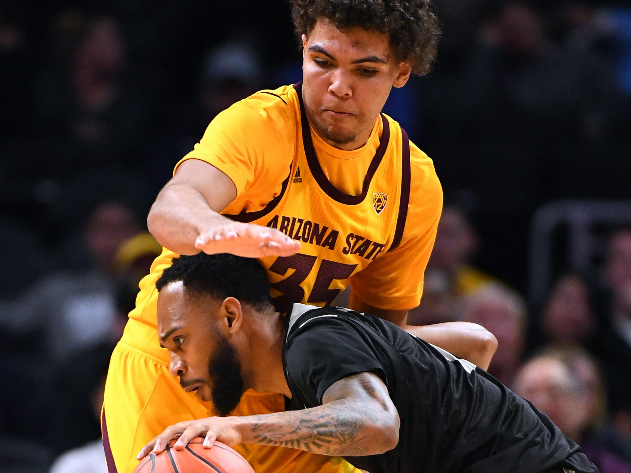 Dec 7, 2018; Los Angeles, CA, USA;  Arizona State Sun Devils forward Taeshon Cherry (35) guards Nevada Wolf Pack guard Corey Henson (2) in the first half of the game at Staples Center. Mandatory Credit: Jayne Kamin-Oncea-USA TODAY Sports