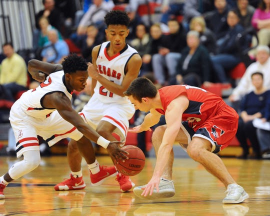 Lebanon's Jahlil Young (2) steals the ball from Red Land's JT Crocenzi (10).