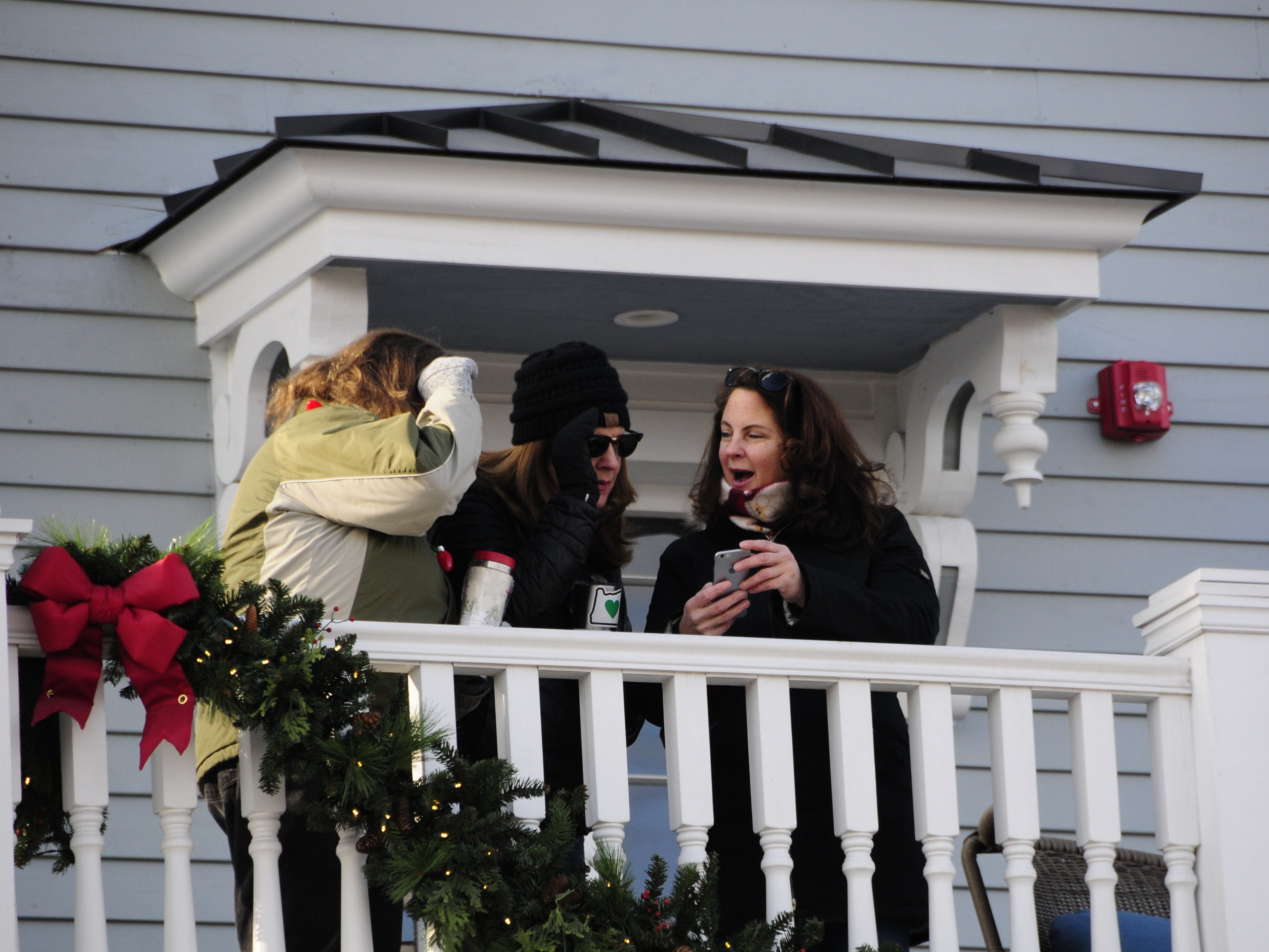 People watch the Lexington Old-Fashioned Christmas Horse Parade on Saturday, Dec. 8, 2018, from the balcony of the Cadillac House.