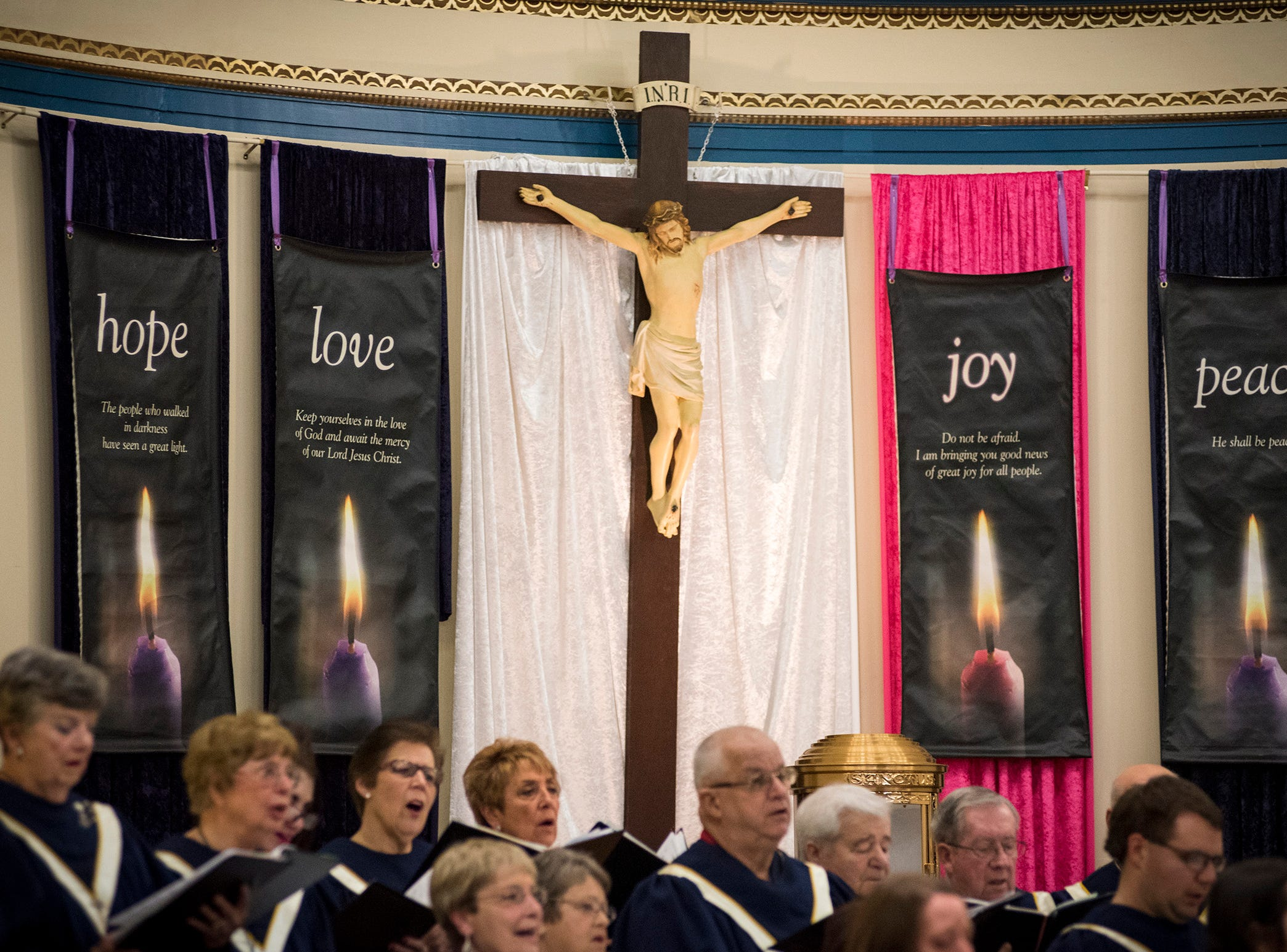 Banners hang alongside a crucifix in the sanctuary of St. Joseph Catholic Church Friday, Dec. 7, 2018 during the annual Advent concert.