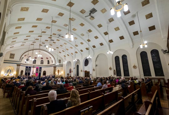 People listen to the annual Advent concert in the nave of the St. Joseph Catholic Church Friday, Dec. 7, 2018. Holy Trinity Parish is taking the first steps toward closing the historic church as a worship site in Port Huron.