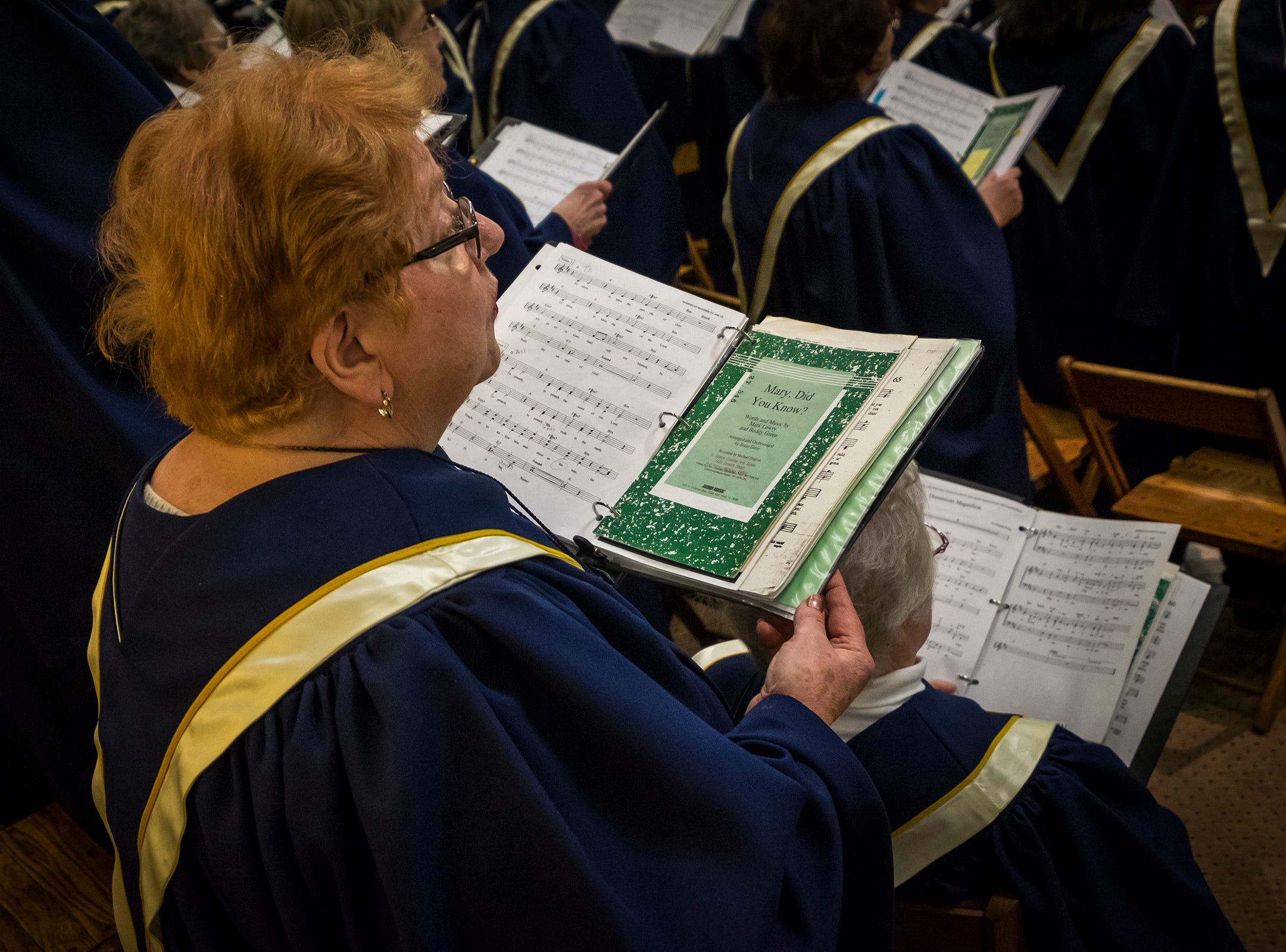 A choirmember holds a songbook Friday, Dec. 7, 2018, during the annual Advent concert at St. Joseph's Catholic Church in Port Huron.