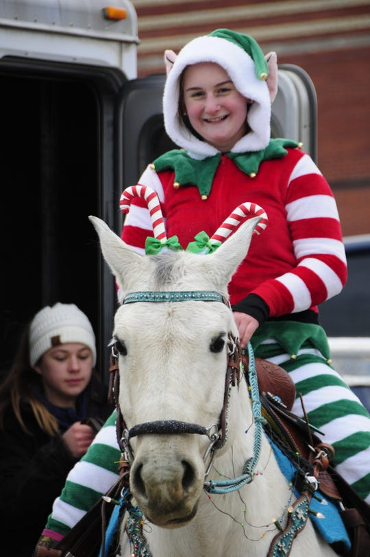 Ava Pink rides Sweetie at the Lexington Old-Fashioned Christmas Horse Parade on Saturday, Dec. 8, 2018.