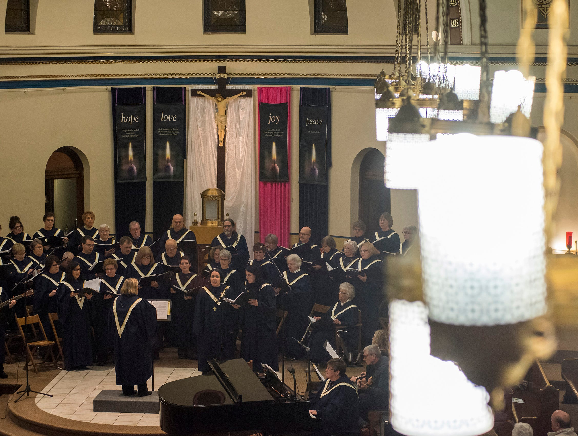 The choirs of St. Joseph of Holy Trinity Parish perform the annual Advent concert from the sanctuary of St. Joseph's Catholic Church Friday, Dec. 7, 2018 in Port Huron.