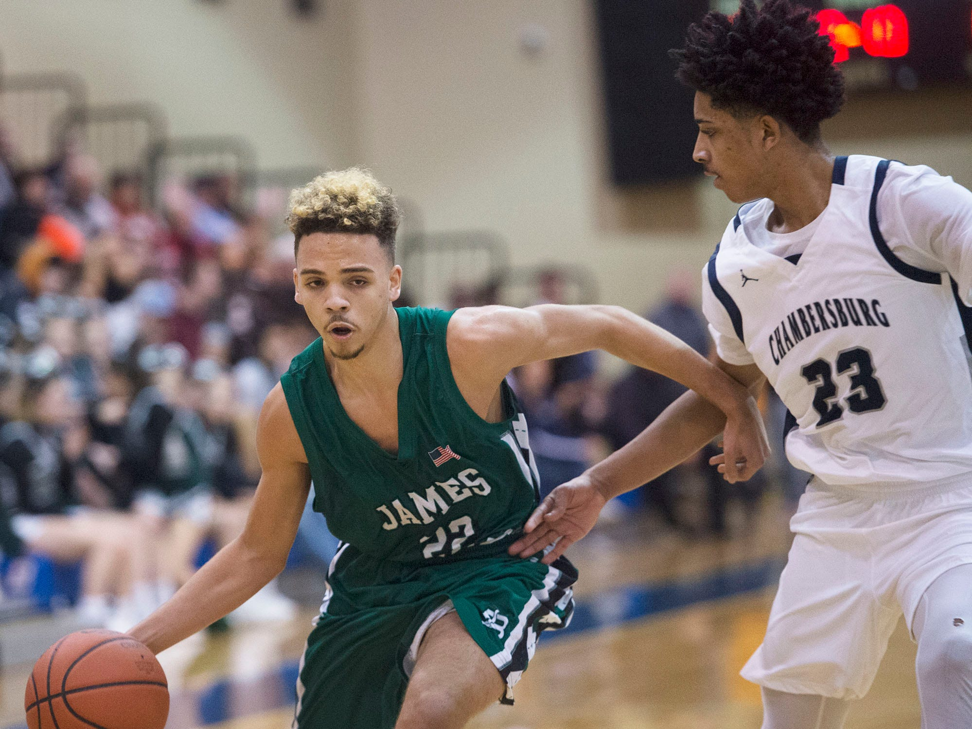 James Buchanan's Donavain Carrington  (22) dribbles past Chambersburg's Max Doctor (23). Chambersburg played James Buchanan boys during the Franklin County Tip-Off Tournament, Friday, Dec. 7, 2018.