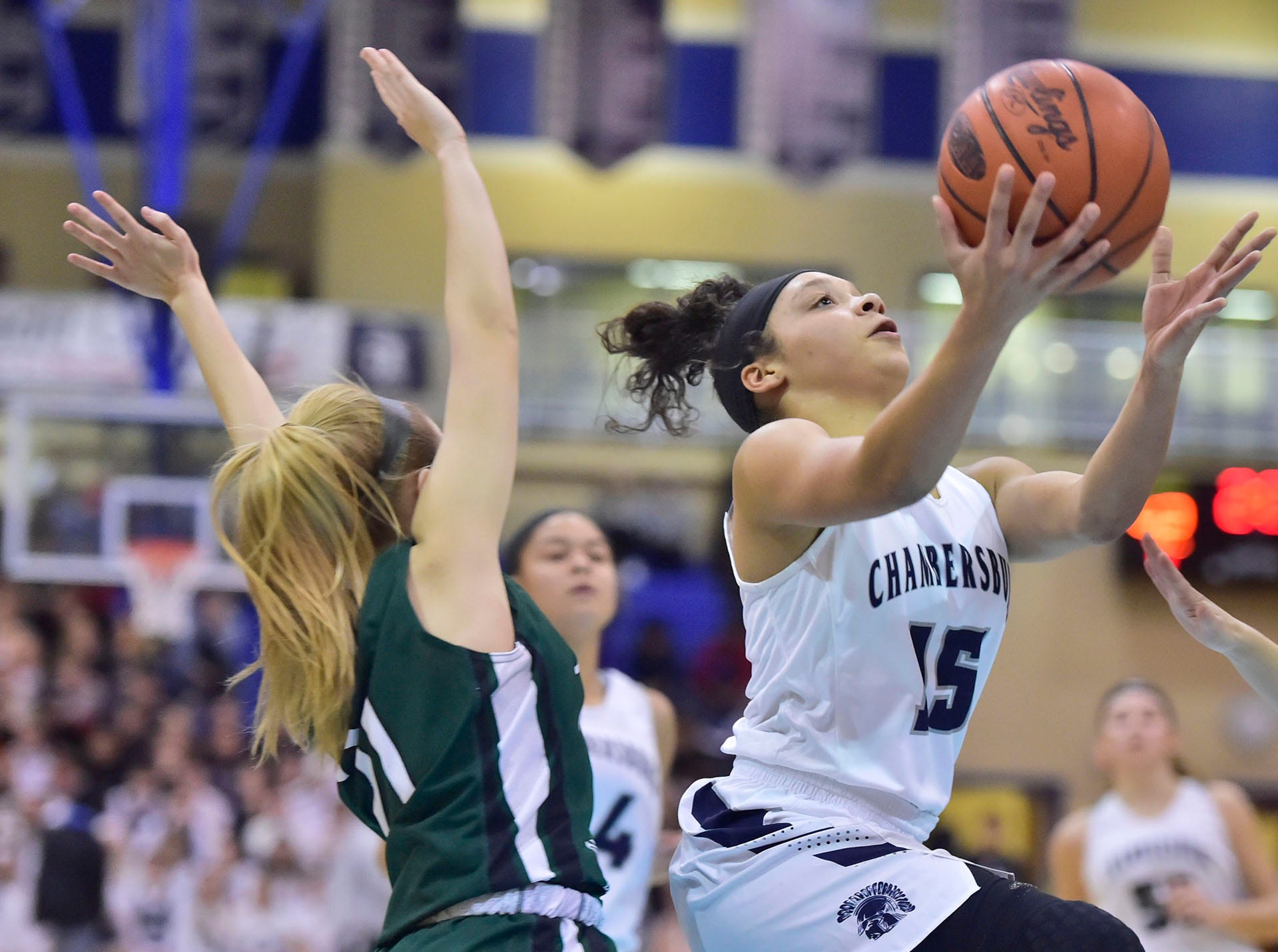 Chambersburg's Bre'ya Clopper (15) drives to the basket to even the score against James Buchanan. Chambersburg played James Buchanan girls during the Franklin County Tip-Off Tournament, Friday, Dec. 7, 2018.