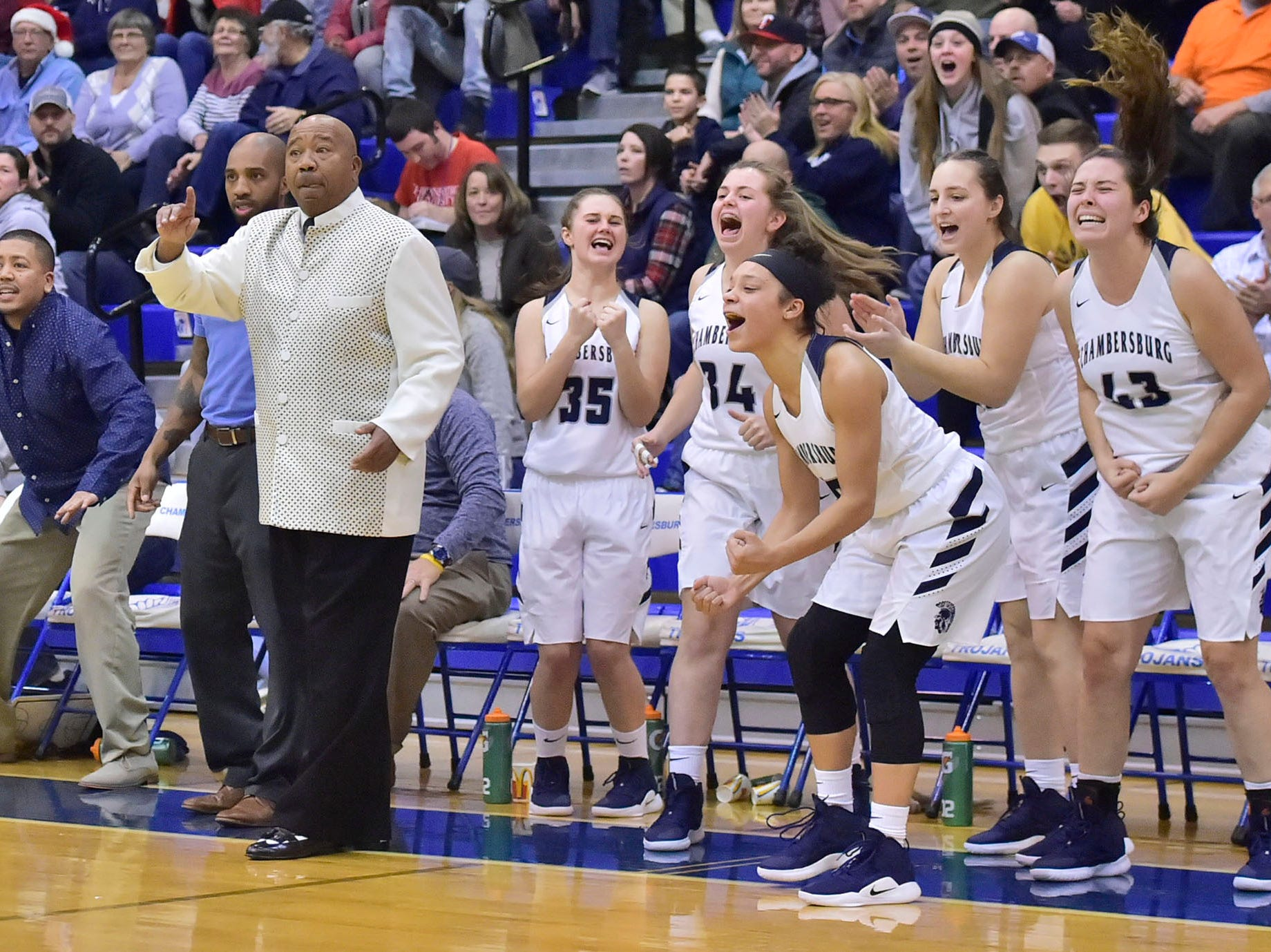 The Trojans bench erupts as they take the lead during OT. Chambersburg played James Buchanan girls during the Franklin County Tip-Off Tournament, Friday, Dec. 7, 2018.