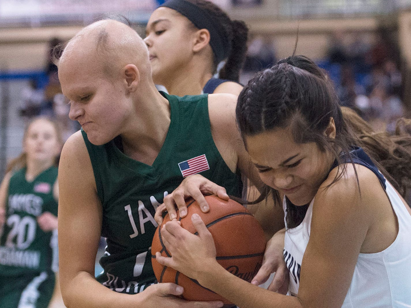 Erin Patillo, right, of Chambersburg  fights for the ball against James Buchanan's Cass Martin. Chambersburg played James Buchanan girls during the Franklin County Tip-Off Tournament, Friday, Dec. 7, 2018.