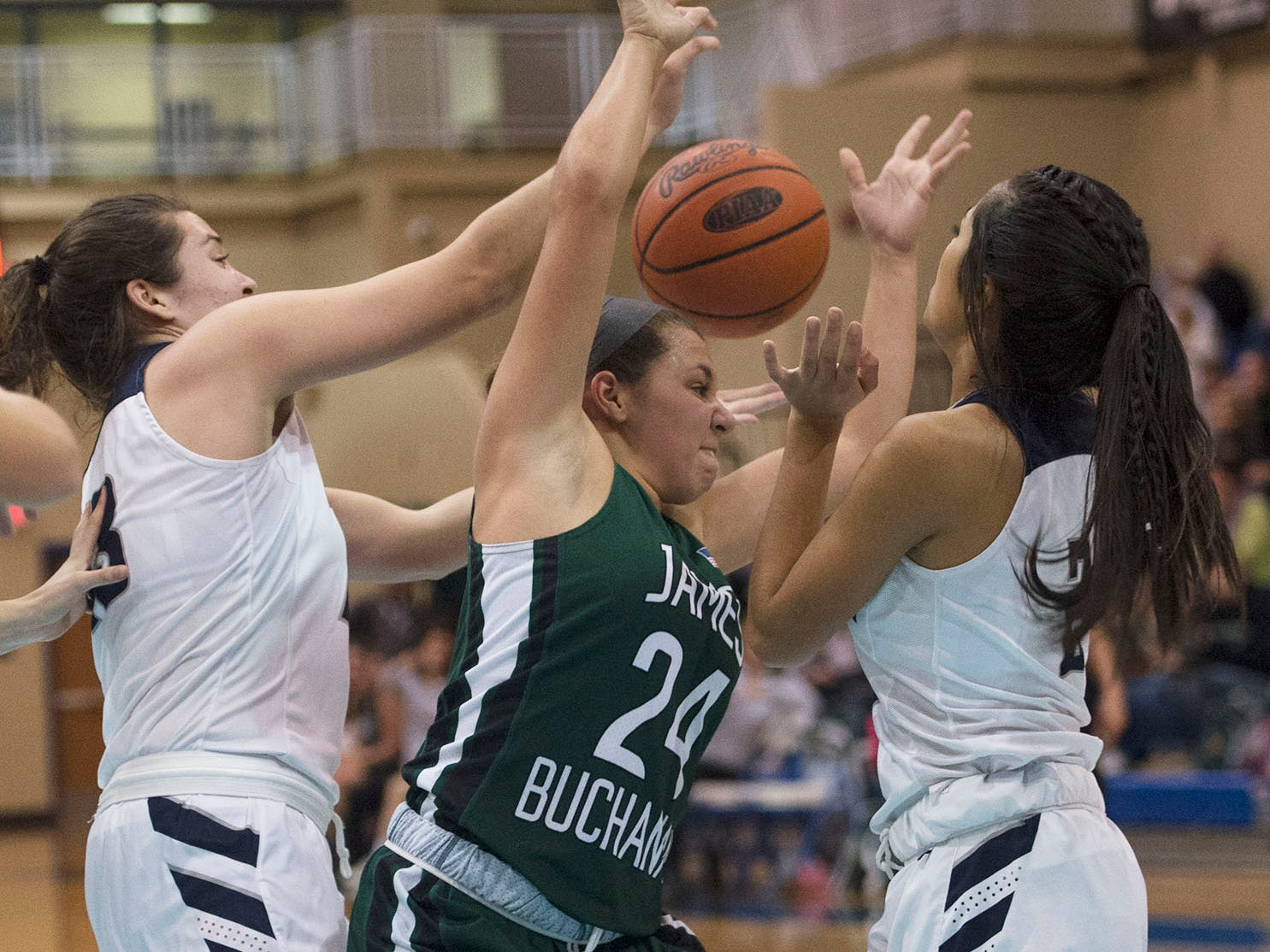 James Buchanan's Alyssa Blair (24) tries to rebound against Trojans players. Chambersburg played James Buchanan girls during the Franklin County Tip-Off Tournament, Friday, Dec. 7, 2018.