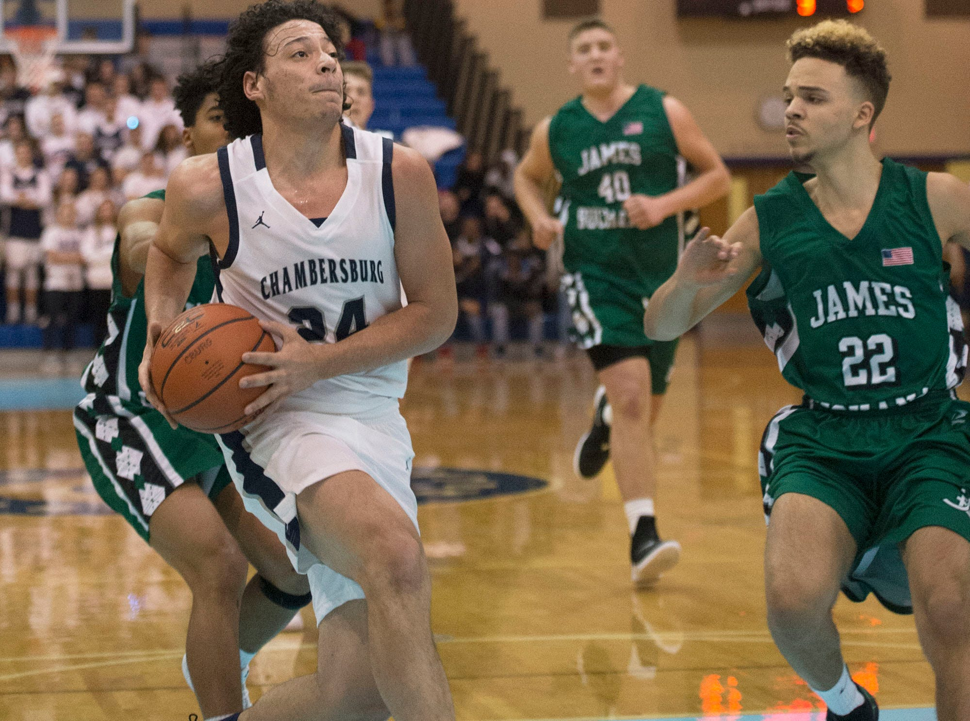 Chambersburg's Ty Holsopple drives to the basket in front of James Buchanan's Donavain Carrington (22). Chambersburg played James Buchanan boys during the Franklin County Tip-Off Tournament, Friday, Dec. 7, 2018.