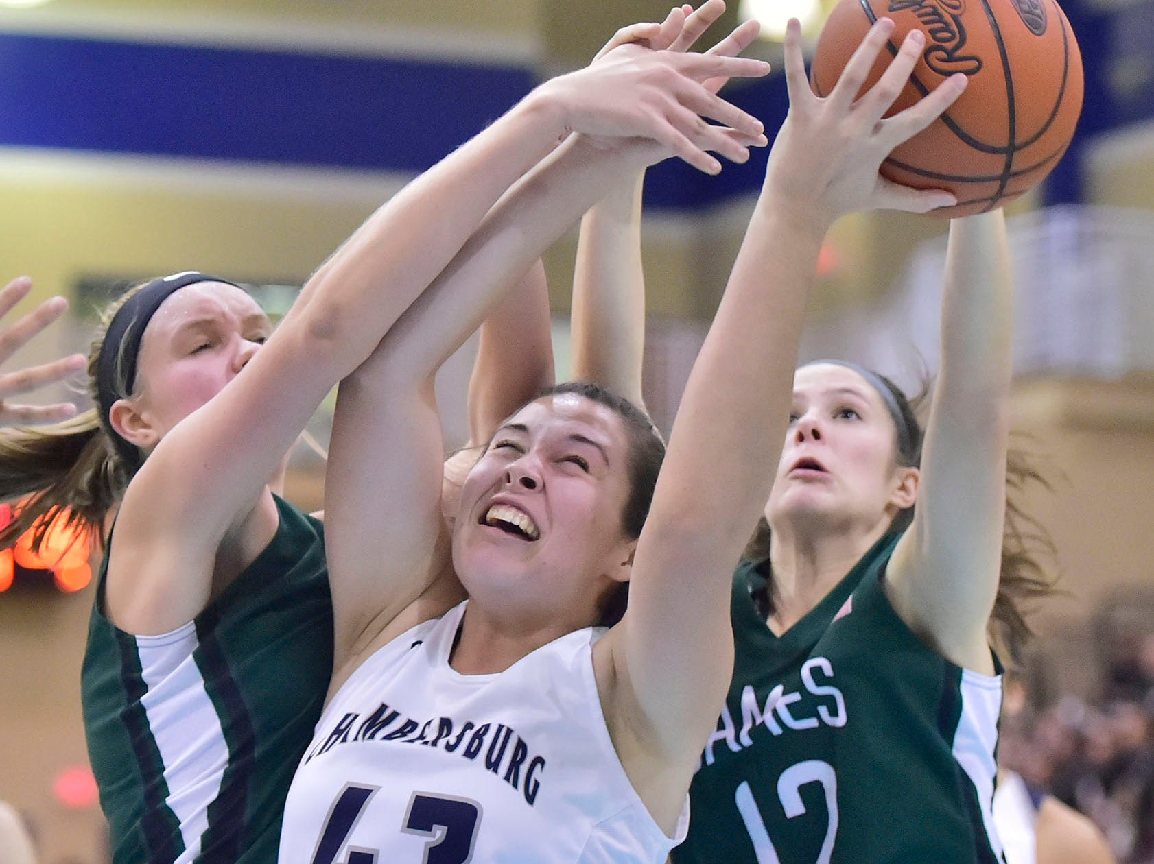 Chambersburg's Ashley Adams (43) is fouled by James Buchanan defenders. Chambersburg played James Buchanan girls during the Franklin County Tip-Off Tournament, Friday, Dec. 7, 2018.