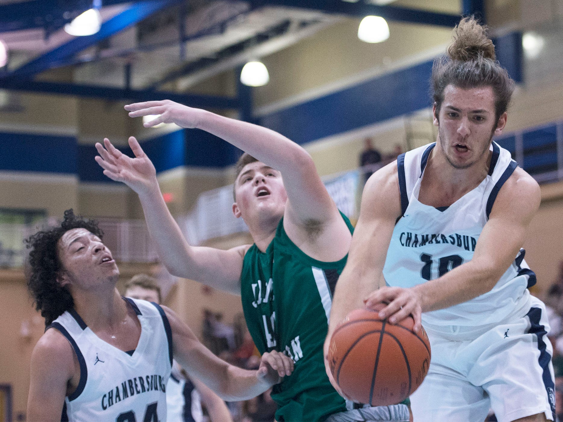Chambersburg's Seth Brouse gets a rebound. Chambersburg played James Buchanan boys during the Franklin County Tip-Off Tournament, Friday, Dec. 7, 2018.