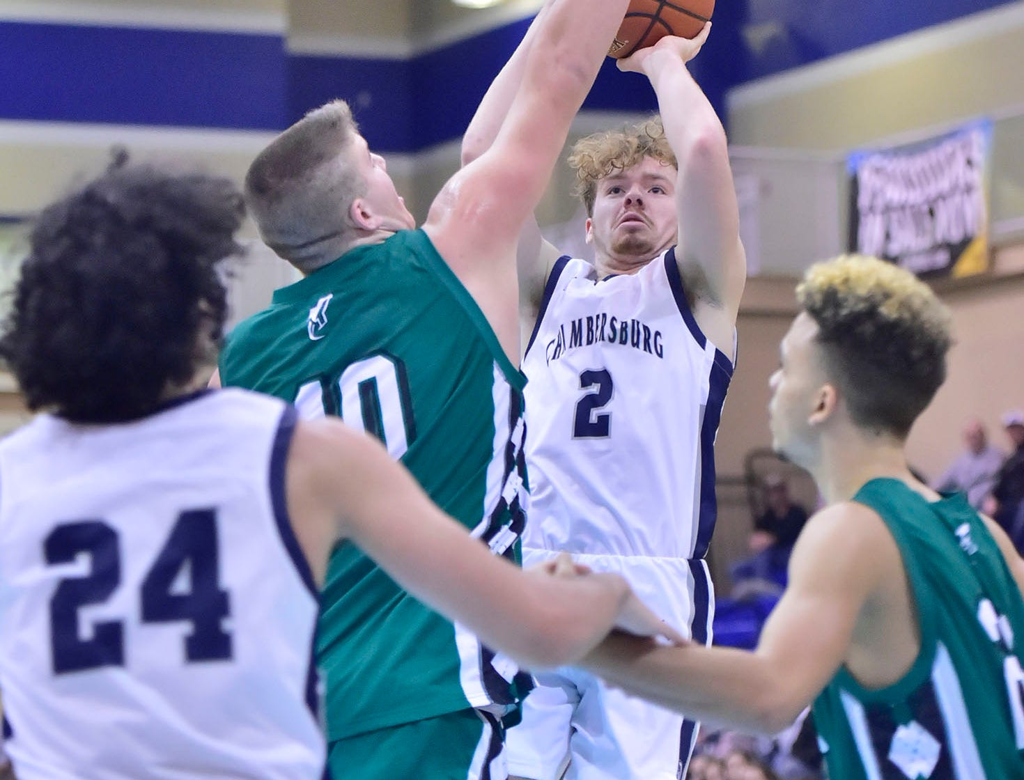 Chambersburg's Tucker Perry (2) shoot over James Buchanan defenders. Chambersburg played James Buchanan boys during the Franklin County Tip-Off Tournament, Friday, Dec. 7, 2018.