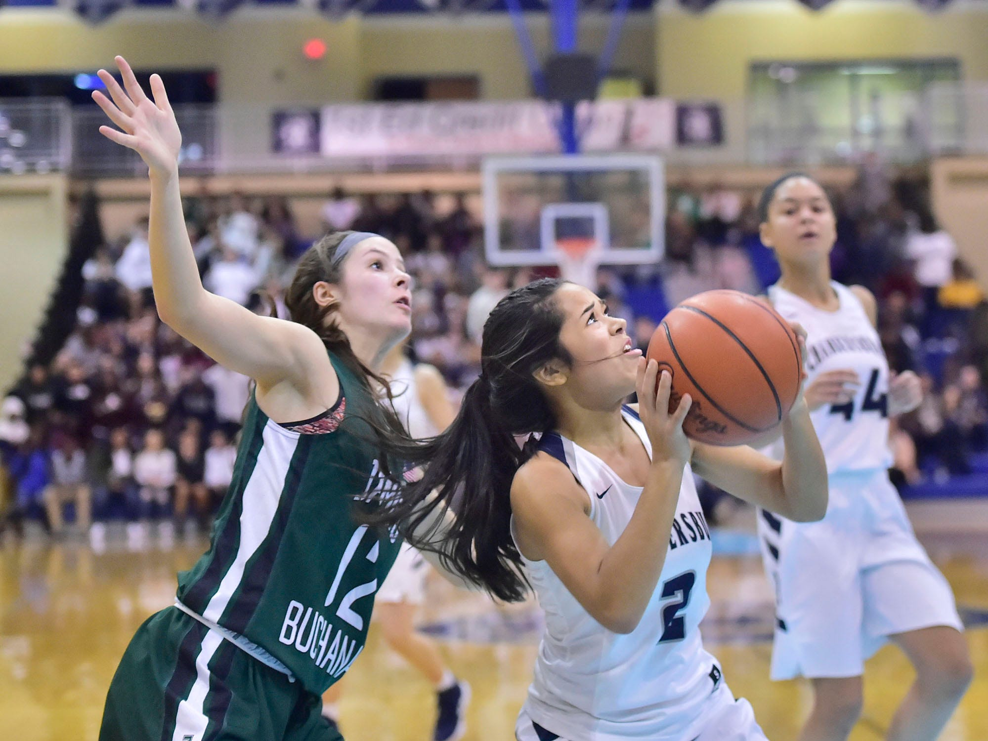 Chambersburg's Erin Patillo (2) drives to the basket to tie the game as James Buchanan's Hannah Kimmel defends during the Franklin County Tip-Off Tournament, Friday, Dec. 7, 2018.