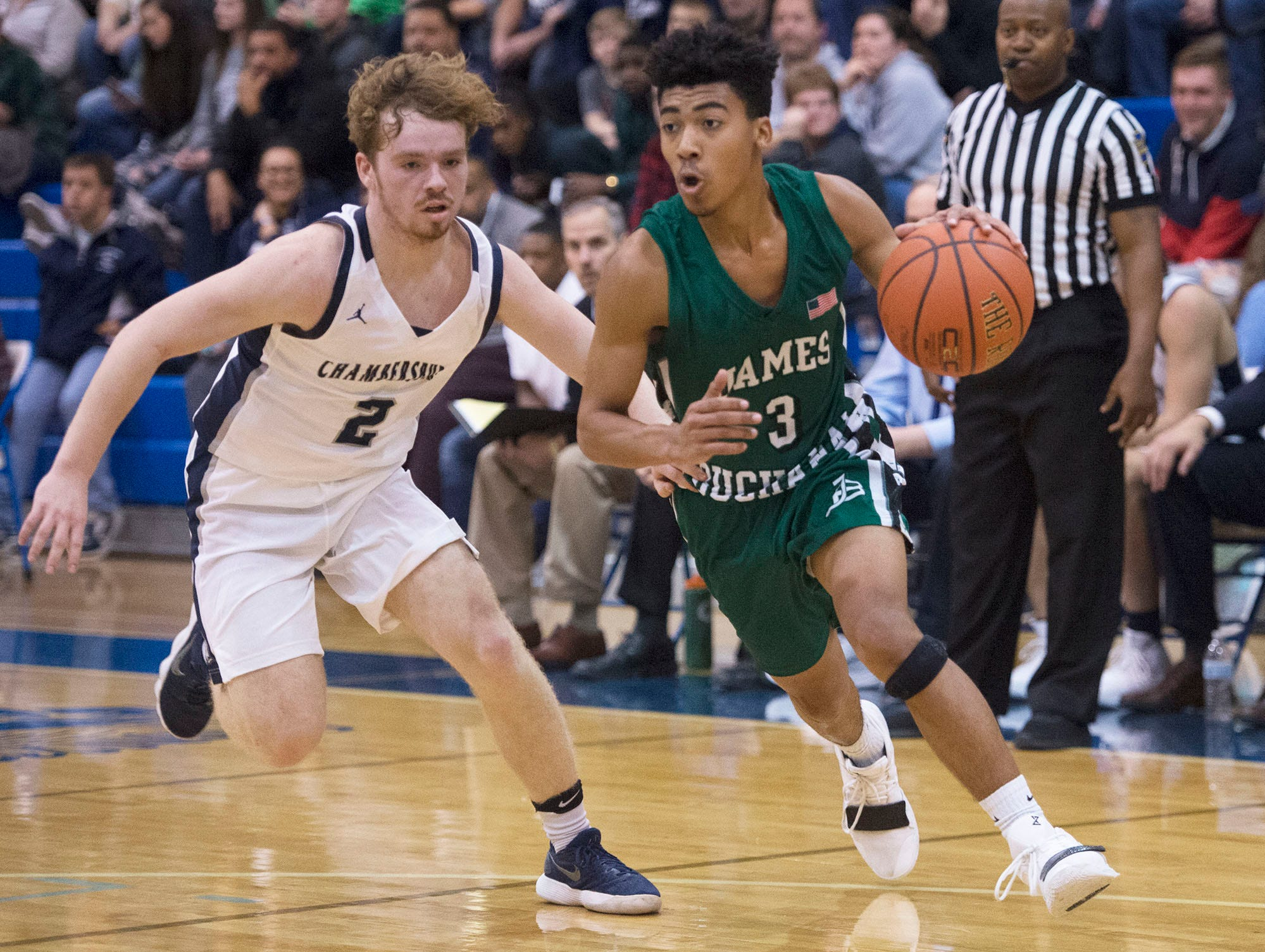 Chambersburg's Tucker Perry guards James Buchanan's Syrus Maldonado. Chambersburg played James Buchanan boys during the Franklin County Tip-Off Tournament, Friday, Dec. 7, 2018.