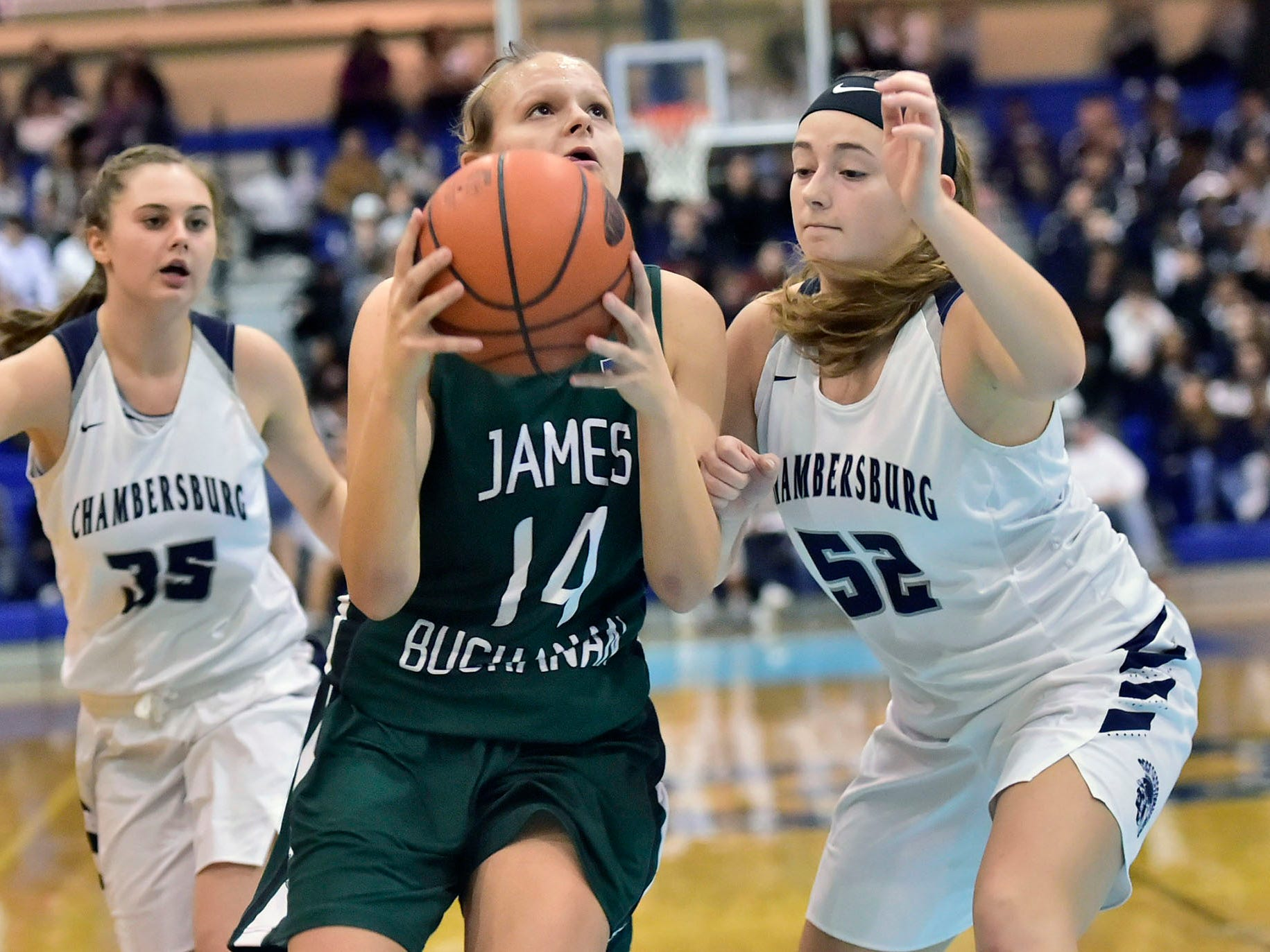 Cass Martin (14) of James Buchanan shoots over Sydney Schmus (35) and Marlee Wrights (52). Chambersburg played James Buchanan girls during the Franklin County Tip-Off Tournament, Friday, Dec. 7, 2018.