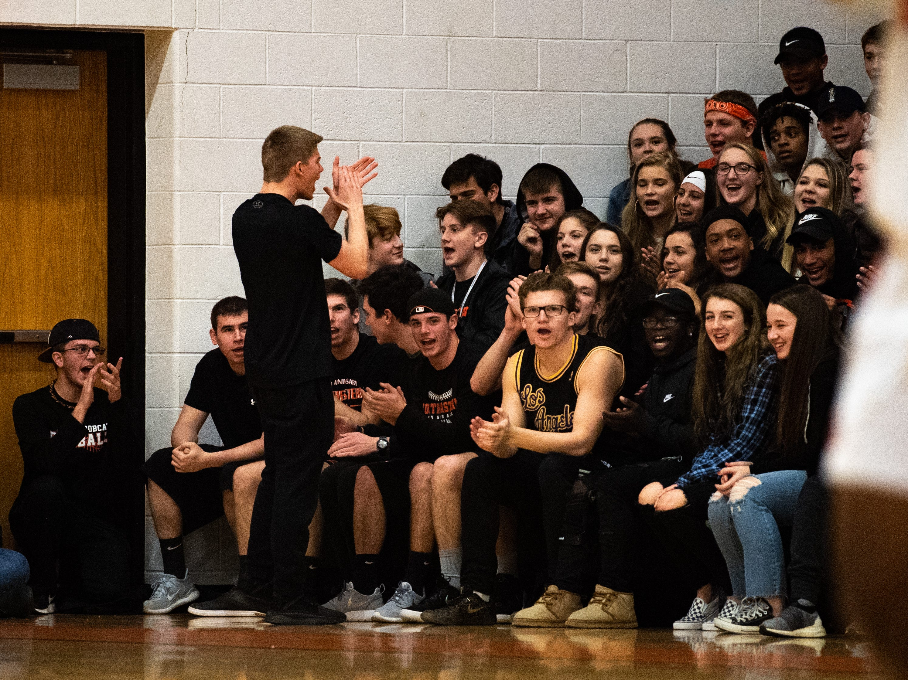 Northeastern's student section taunts Columbia during the YAIAA Boys' basketball game between Columbia and Northeastern at Northeastern High School, Friday, December 7, 2018. The Bobcats defeated the Crimson Tide 65 to 51.