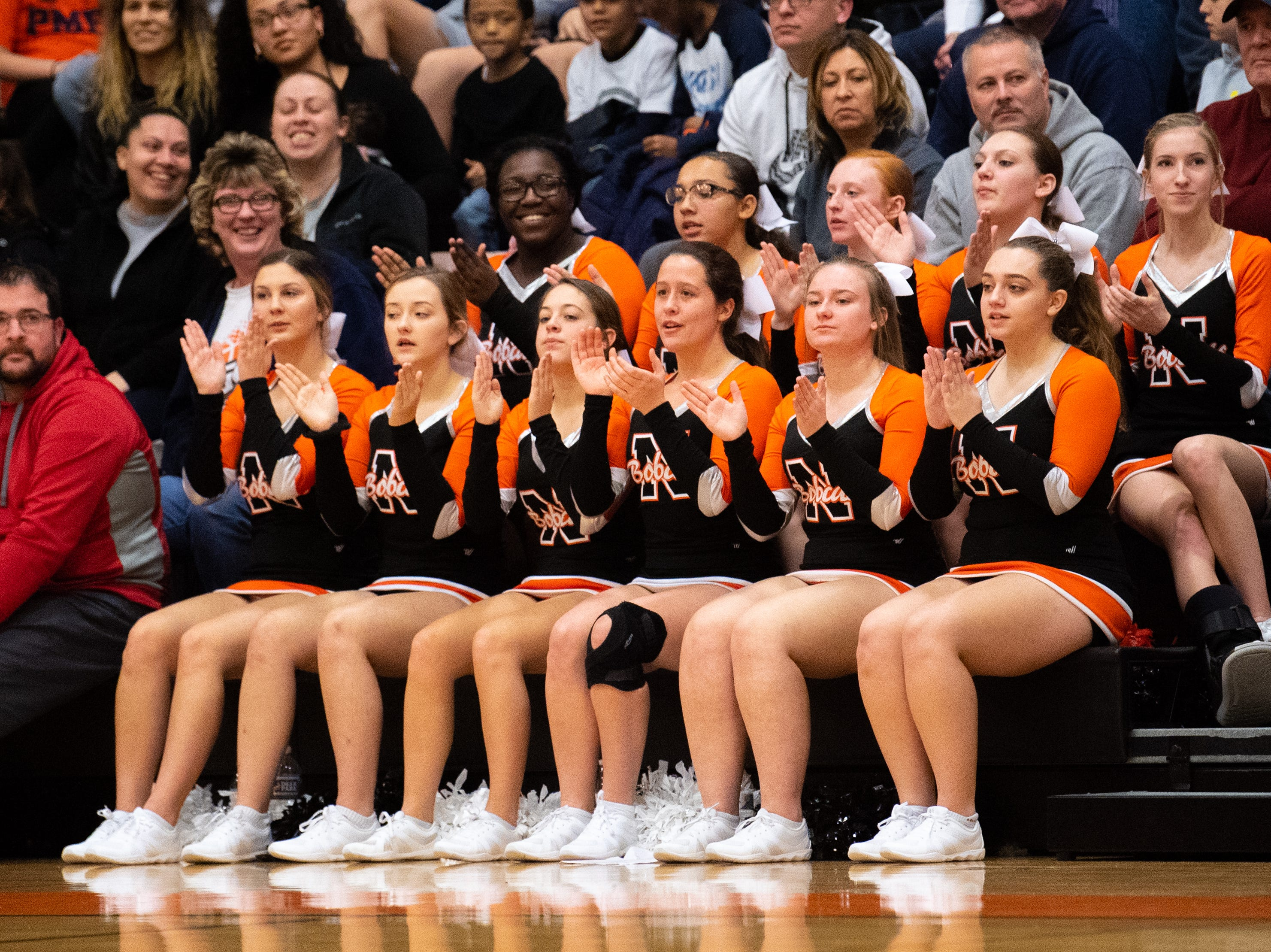 Northeastern's cheerleaders keep the crowd's energy up during the YAIAA Boys' basketball game between Columbia and Northeastern at Northeastern High School, Friday, December 7, 2018. The Bobcats defeated the Crimson Tide 65 to 51.