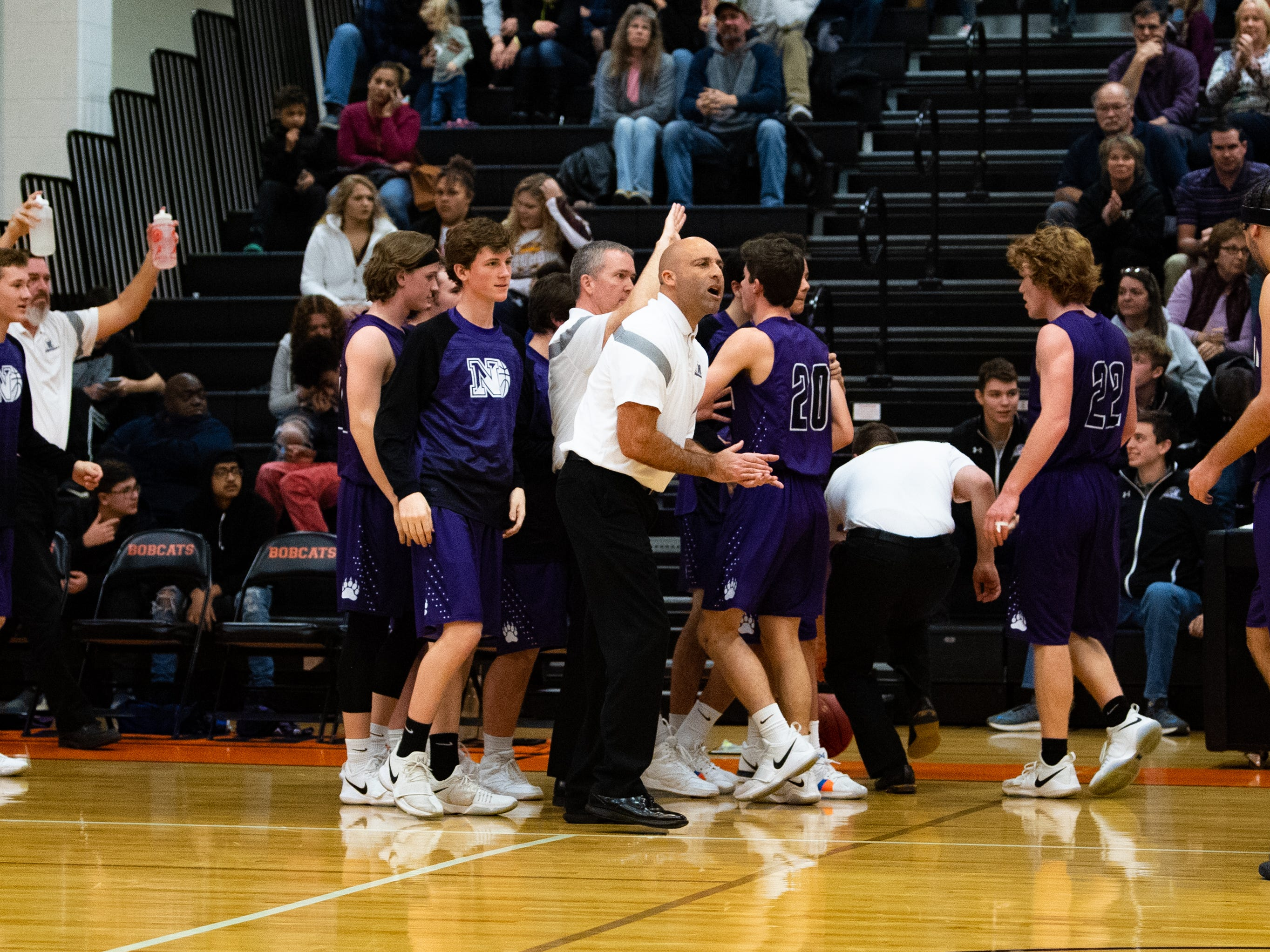 Northern York celebrates during a time-out at Northeastern High School, Friday, December 7, 2018. The Polar Bears defeated the Knights 67 to 53.