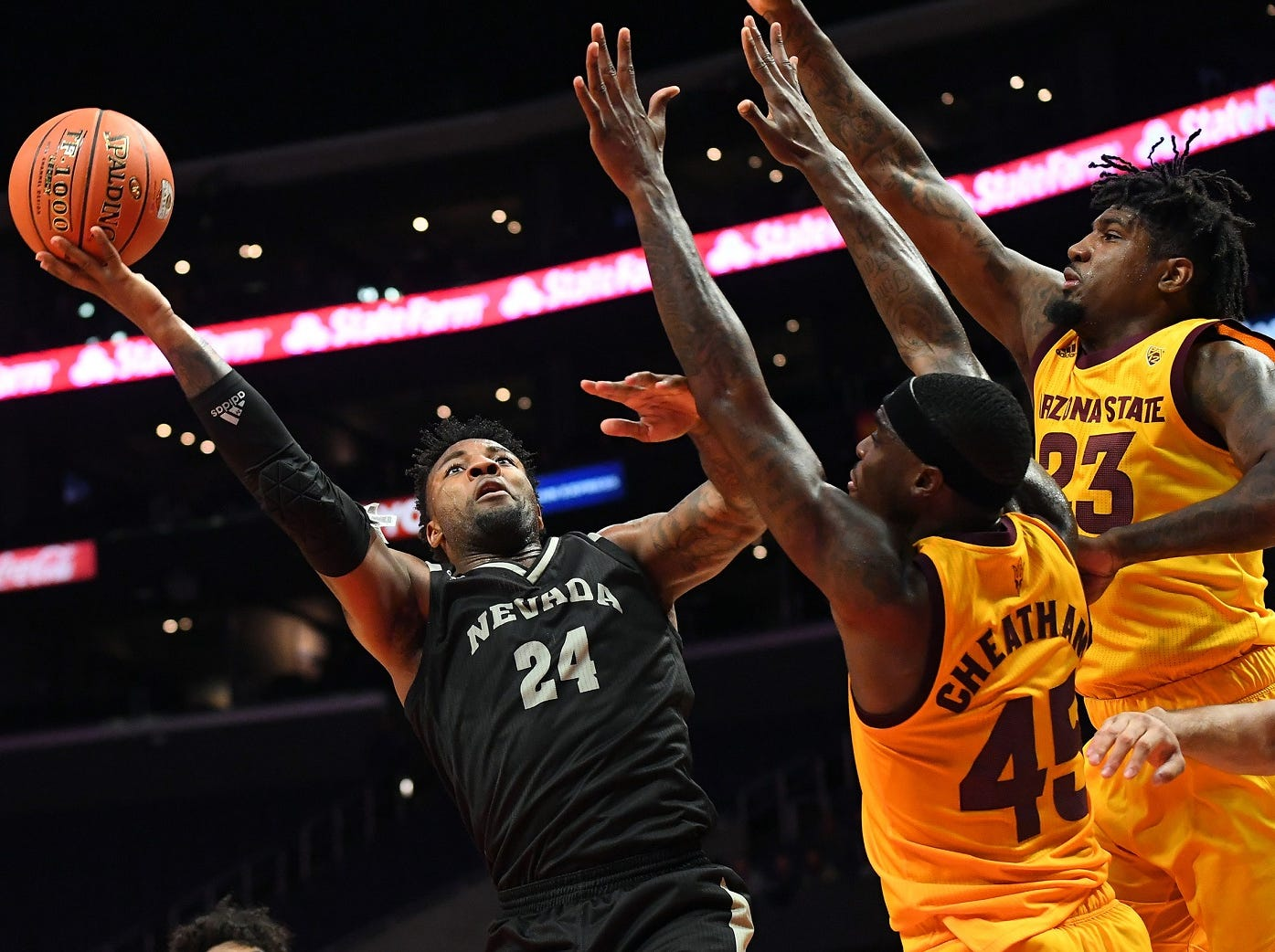 Arizona State's Zylan Cheatham (45) and forward Romello White (23) defend against Nevada's Jordan Caroline on Friday night at Staples Center.