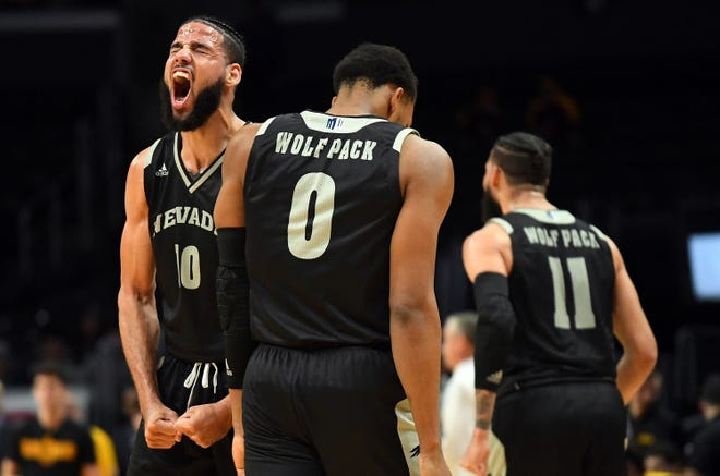 Nevada's Caleb Martin (10) reacts after getting fouled as he scored during the second half Friday night against Arizona State at Staples Center.