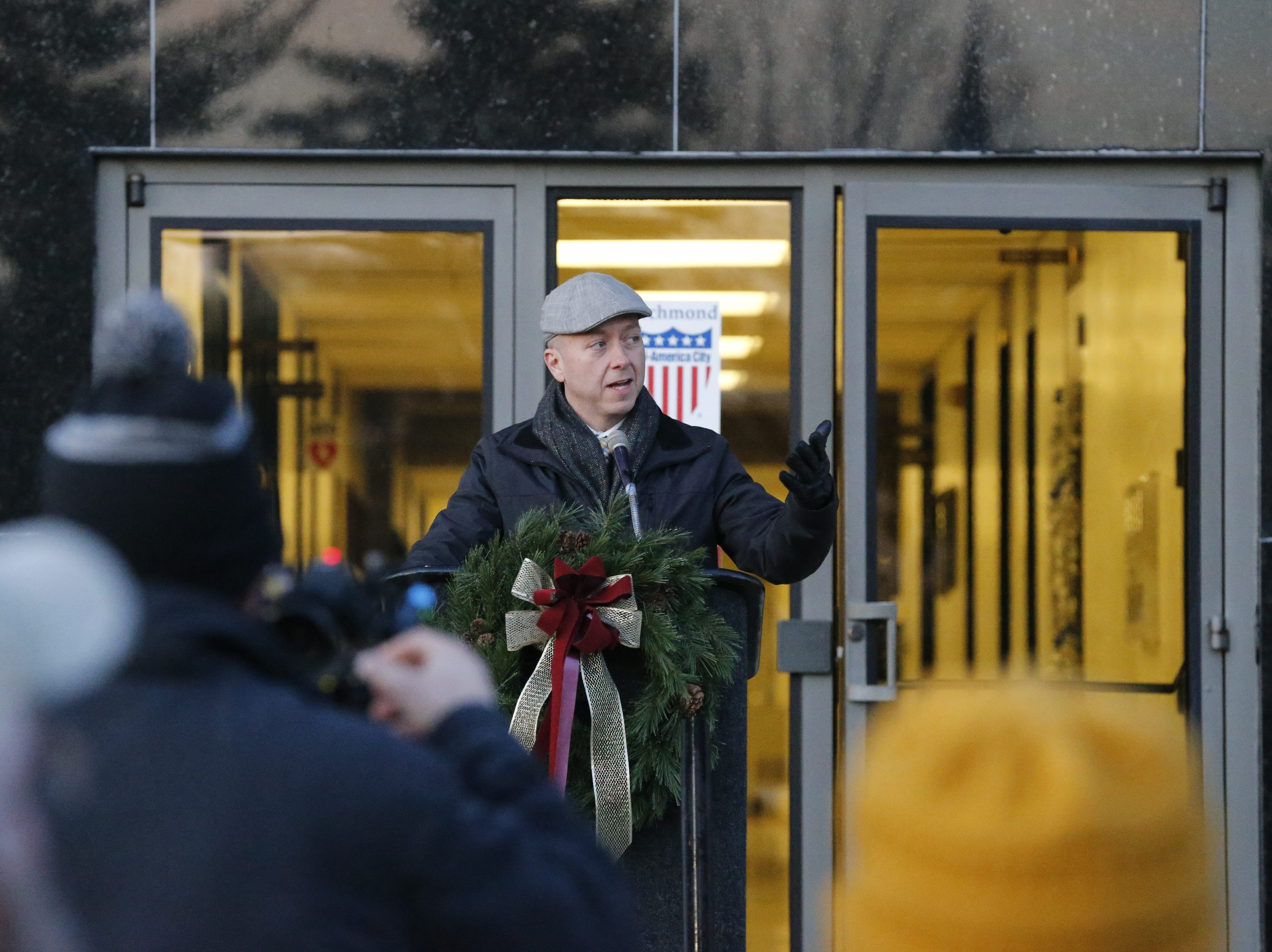 Mayor Dave Snow speaks outside the Richmond Municipal Building before the lighting of the holiday tree on Friday, Dec. 7, 2018.