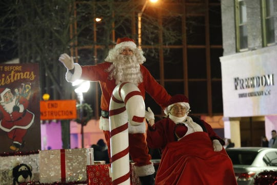 Santa Claus greets the crowd during Richmond's Holiday Parade downtown in 2018.