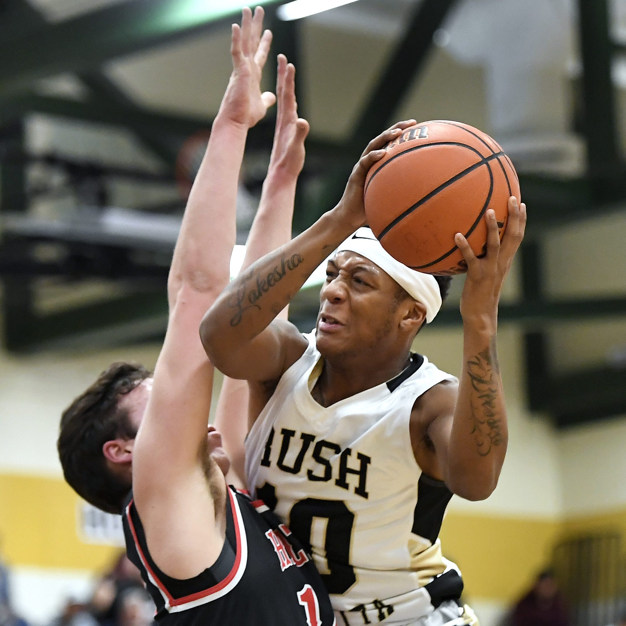Rush-Henrietta's Timmy Jackson, right, is defended by Hilton's Mitchell Carr during a regular season game played at Rush-Henrietta High School, Friday, Dec. 7, 2018. Hilton beat Rush-Henrietta 61-47.