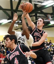 Hilton's Mitchell Carr, right, blocks a shot by Rush-Henrietta's Nyles Goodwin during a regular season game played at Rush-Henrietta High School, Friday, Dec. 7, 2018. Hilton beat Rush-Henrietta 61-47.