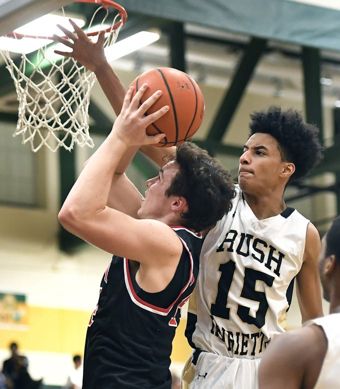 Rush-Henrietta's Javonte Williams, right, defends against Hilton's Mitchell Carr during a regular season game played at Rush-Henrietta High School, Friday, Dec. 7, 2018. Hilton beat Rush-Henrietta 61-47.